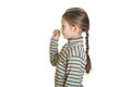Little girl is preparing to throw a dart on white background isolated Royalty Free Stock Image