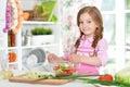Little girl preparing vegetable salad Royalty Free Stock Photo