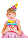 Little girl with presents and party hat Royalty Free Stock Photography