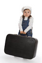 Little girl pulling a heavy suitcase over white background Royalty Free Stock Photography