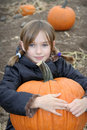 Little Girl in Pumpkin Patch Royalty Free Stock Photo