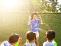 Little girl Punishment for water gun spray to wet body Royalty Free Stock Photo