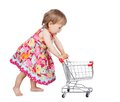 Little girl pushing a trolley Stock Photo