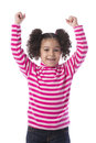 Little girl raising her arms isolated on white background Stock Images