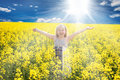 Little girl in rape field Stock Photo