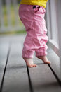 Little girl reaching up outdoors Royalty Free Stock Images