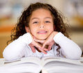 Little girl reading a book Stock Photography