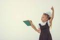 Little girl reading book, preparing for school