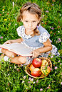 Little girl reads book Stock Images