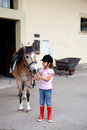 Little girl ready for a horseback riding lesson Royalty Free Stock Photos