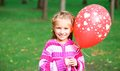 Little girl with red balloon Stock Photography