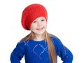 Little girl in a red cap smiles isolation on white Royalty Free Stock Photos