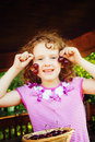 Little girl with red cherry in her hand. Royalty Free Stock Photo