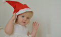 Little girl with a red christmas hat on the head Stock Image