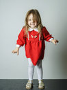 Little girl in red dress frighten photographer cute Royalty Free Stock Image