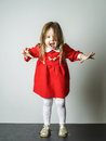 Little girl in red dress frighten photographer cute Royalty Free Stock Photo