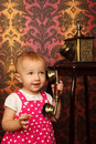 Little girl in red dress talking vintage phone Stock Image