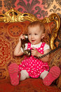 Little girl in red dress talking vintage phone. Stock Photography