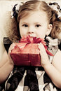 Little girl with a red gift box Stock Image