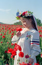 Little girl on red poppy field Royalty Free Stock Photo