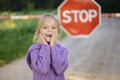 Little girl about red sign beautiful stop Royalty Free Stock Photos