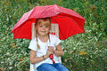 Little girl with red umbrella Stock Photography