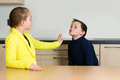 Little girl rejects little boy trying to kiss her Royalty Free Stock Photo