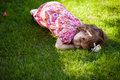 Little girl relaxing in a park pretty laying on the grass and Stock Photos