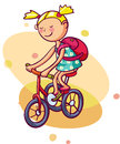 Little girl rides a bicycle kid enjoys summer Stock Images