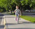 Little Girl Riding a Bike Stock Image