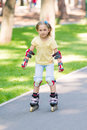 Little girl rollerskating in the park outdoor Stock Photography
