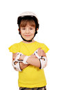 Little girl with rolling skates protective gear posing Royalty Free Stock Photography