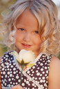 Little girl with rose. Royalty Free Stock Photography
