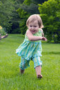 Little girl running Royalty Free Stock Image