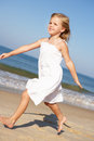 Little Girl Running Along Beach Royalty Free Stock Photography