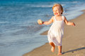 Little girl running on the beach Royalty Free Stock Photos