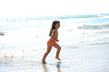 Little girl running on the beach Stock Photography