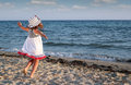 Little girl running on beach happy Royalty Free Stock Photo