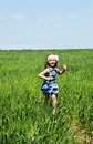 Little girl running on a meadow happy Stock Photo