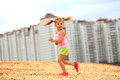 Little girl running in sand Royalty Free Stock Photo