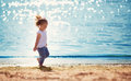 Little girl running at the sea Royalty Free Stock Photo