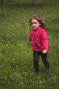 Little girl running in a spring plum orchard Royalty Free Stock Photo