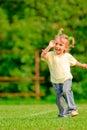 Little girl runs across field Stock Images
