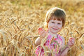 Little girl in rye wheat field Stock Image