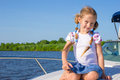 Little girl sailing on a luxury yacht Royalty Free Stock Photo