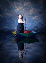 Little girl sailing using the umbrella Royalty Free Stock Photo