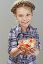 Little girl with salad beautiful laughing and holding on gray background Stock Photos