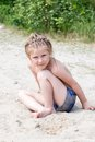 Little girl on the sand Royalty Free Stock Photo