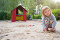 Little girl in a sandbox Royalty Free Stock Photo