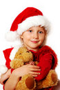 Little girl in santa cloth with teddy bear Stock Image